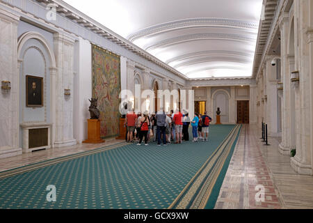 Group of visitors inside the Palace of the Parliament Palatul Parlamentului the second largest administrative building - Stock Photo