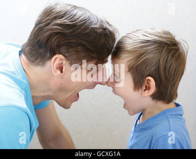 father and son swear, scream and quarrel - Stock Photo
