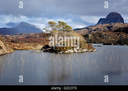 Two mountains of Silvan and Canisp from Loch Druim Suardalain, Sutherland, Scotland, United Kingdom, Europe - Stock Photo