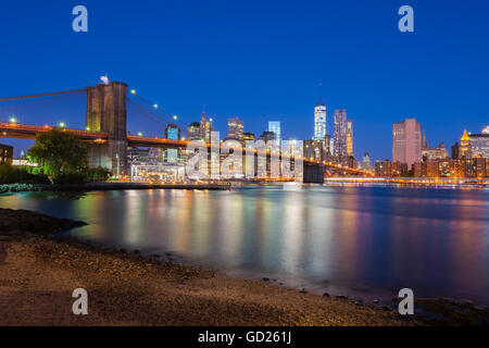 Brooklyn Bridge over East River, Lower Manhattan skyline, including Freedom Tower of World Trade Center, New York, - Stock Photo