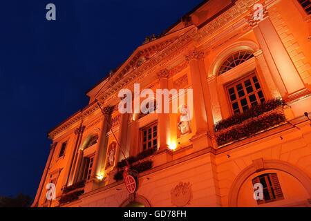 Facade of city hall in Lugano, Switzerland, illuminated at night - Stock Photo