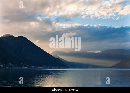 Boka Kotorska (the Bay of Kotor) from the village of Dobrota, Montenegro at evening - Stock Photo