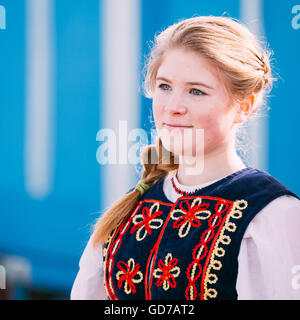 Gomel, Belarus - March 12, 2016: Portrait of unknown beautiful young woman girl in national folk clothes at Celebration - Stock Photo