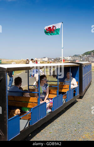 UK, Wales, Gwynedd, Penrhyn Point,  passengers on Fairbourne Miniature Railway train at Barmouth Ferry station - Stock Photo