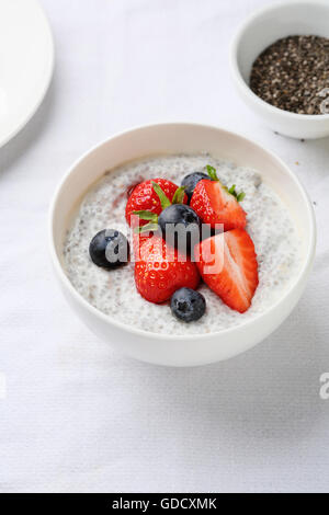 chia seeds pudding  with fresh berry in white bowl - Stock Photo