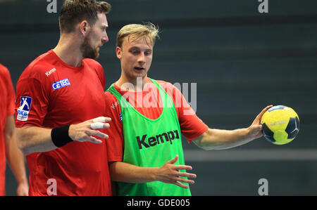 Magdeburg, Germany. 15th July, 2016. Swedish new recruit Daniel Pettersson (R) of the German Bundesliga handball - Stock Photo