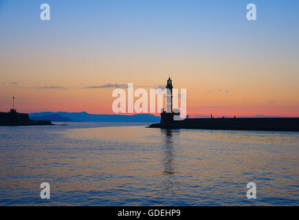 Silhouette of Lighthouse at sunset, chania, Crete, Greece - Stock Photo