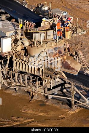 Two men near conveyor belt, mining area Garzweiler II, lignite, opencast mining, Garzweiler, Jüchen - Stock Photo