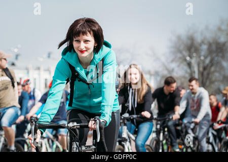 Gomel, Belarus - April 10, 2015: Group of young people cyclists ride on street at opening of the cycling season - Stock Photo