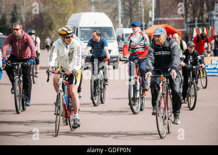 Gomel, Belarus - April 10, 2015: Group of people cyclists ride on street at opening of the cycling season in the - Stock Photo