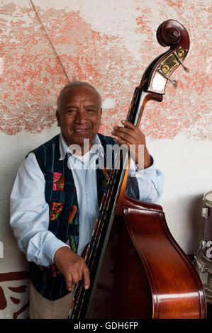 Man playing a double bass, Antigua, Guatemala, Central America - Stock Photo