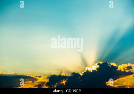 Sunset clouds with sun rays - Stock Photo