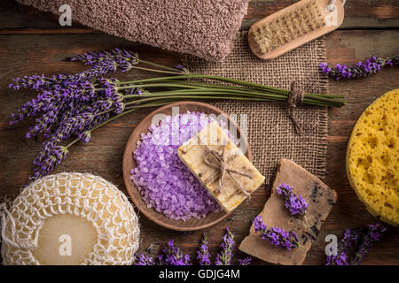 Natural soap, lavender and salt on a wooden board - Stock Photo