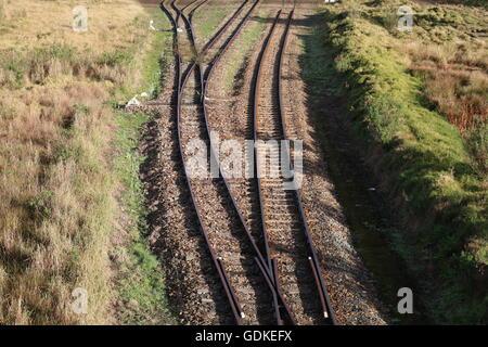 railway tracks countryside trains locomotives - Stock Photo