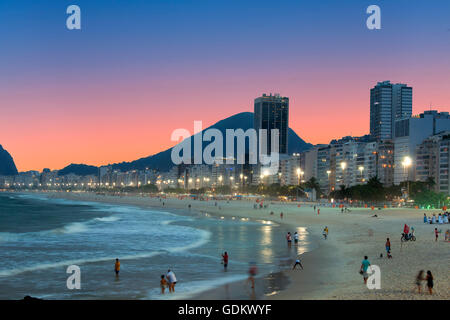 Copacabana beach at night in Rio de Janeiro - Stock Photo