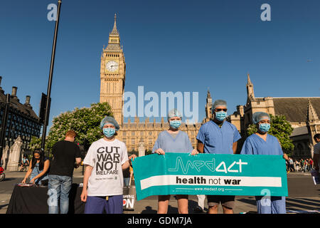 London, UK. 18th July 2016. Anti-nuclear campaigners gathered in Parliament Square to protest against renewal of - Stock Photo