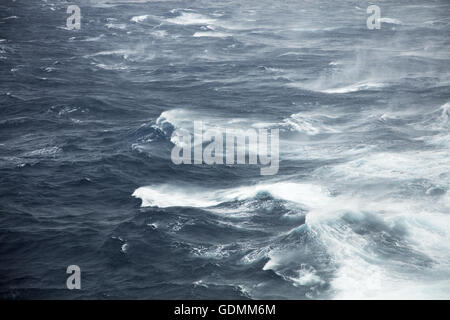Winds whip up the sea during a fierce storm in mid Atlantic Ocean - Stock Photo
