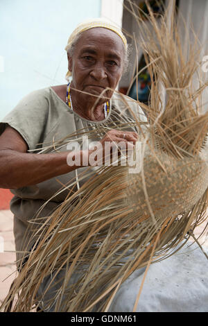 Woman making a sombrero hat in a craft market in Trinidad, Cuba - Stock Photo