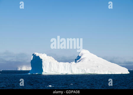 Large Iceberg floating out into cold ocean sea from Ilulissat Icefjord above the Arctic Circle. Disko Bay. Ilulissat - Stock Photo