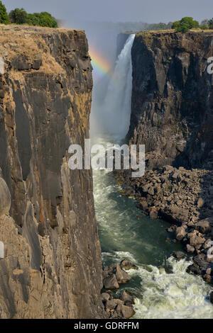 Rainbow over Victoria Falls, Matabeleland North Province, Zimbabwe - Stock Photo