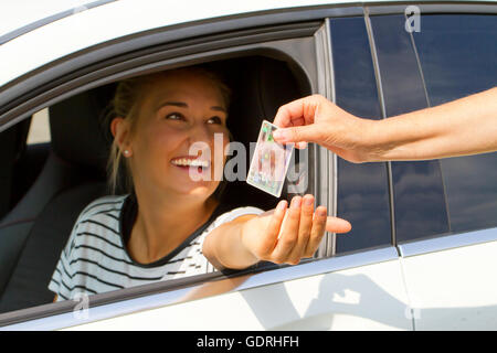 Young woman getting her driver license - Stock Photo