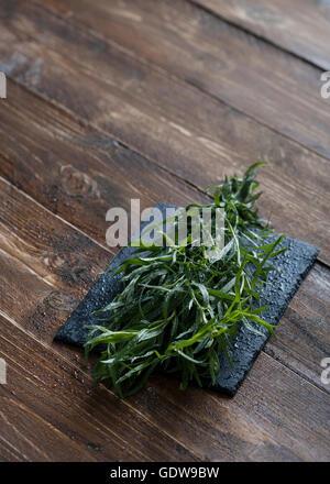 Fresh Tarragon on a table - Stock Photo