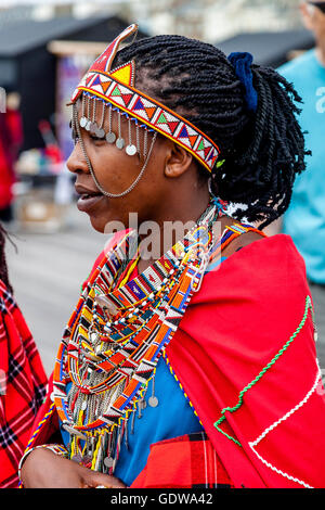 An African Woman Dressed In Traditional Costume On Hastings Pier During The Annual Pirate Day Festival, Hastings, - Stock Photo
