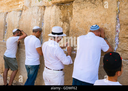 Israel Jerusalem Old City Western Wall religious Jews Jewish men praying at wall - Stock Photo