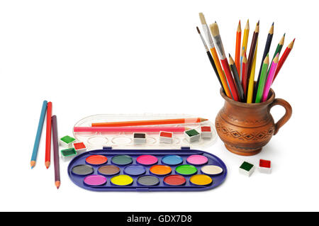 watercolor paint and colored pencils isolated on white background - Stock Photo