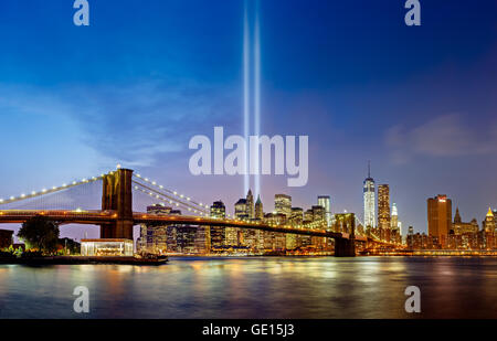 Tribute in Light, September 11 Commemoration, with the Brooklyn Bridge and Lower Manhattan skyscrapers, New York - Stock Photo