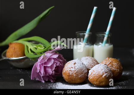 Jelly doughnuts and two bottles of milk - Stock Photo