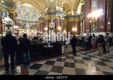 Mass at St. Stephen's Basilica (Roman Catholic Cathedral). It is  Budapest's largest Church in Budapest,Hungary - Stock Photo