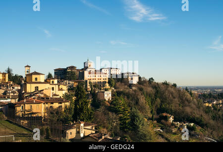 View over Citta Alta or Old Town buildings in the ancient city of Bergamo, Lombardia, Italy on a clear day - Stock Photo