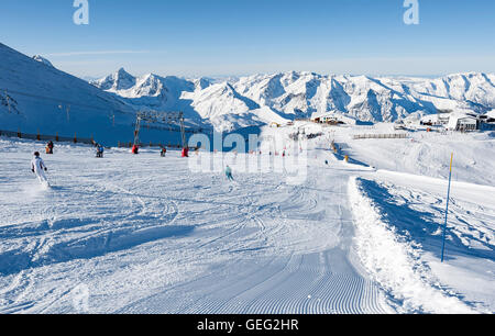 People skiing in the ski resort called 'les Deux Alpes'. France, Europe - Stock Photo