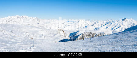 People skiing in the ski resort called 'les Deux Alpes'. We can see on the right the famous Mont Blanc. France, - Stock Photo