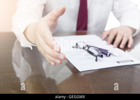 businessman extending hand to shake. Business meeting concept. Offering for handshake. - Stock Photo