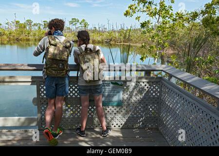 Florida, Big Pine Key, National Key Deer Refuge, The Blue Hole, abandoned limestone quarry, visiting couple - Stock Photo