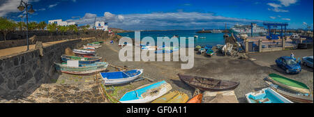 Colorful boats in a harbour in Playa Blanca, Lanzarote, Canary Islands, Spain. Picture taken 19 April 2016 - Stock Photo