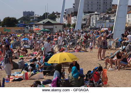 Jubilee Beach in Southend-On-Sea, Essex. Crowded with sunseekers in a heatwave. - Stock Photo