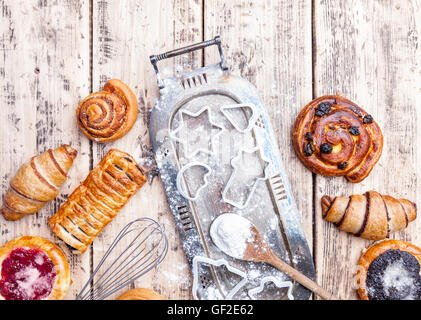 Delicious Christmas holiday baking background with ingredients and utensils - Stock Photo