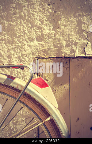 Detail of retro bicycle wheel. It looks part of the rear fender and the brake. Vintage style. Vertical image. - Stock Photo