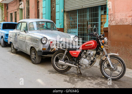 Classic old American car and motorbike in Old Havana (La Habana Vieja), Havana, Cuba - Stock Photo