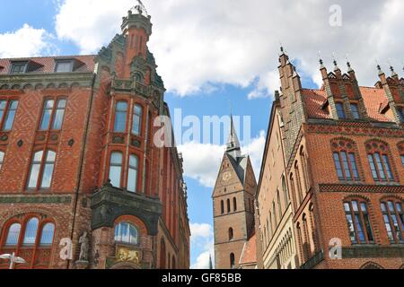 Old Town Hall, Town House and Market Church in Hanover, North Germany, Europe. The Houses are built in Brick Architecture. - Stock Photo
