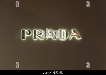 PRADA company logo, an Italian luxury fashion house specialising leather goods and fashion accessories. - Stock Photo