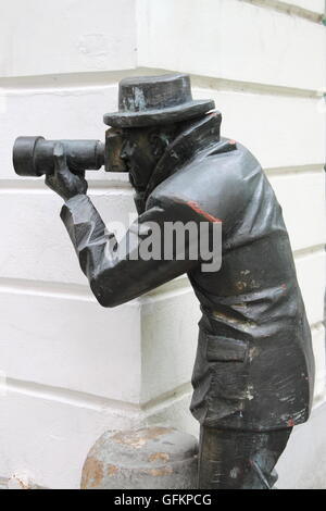 Bronze statue of a paparazzi taking pictures in Bratislava, Slovakia - Stock Photo