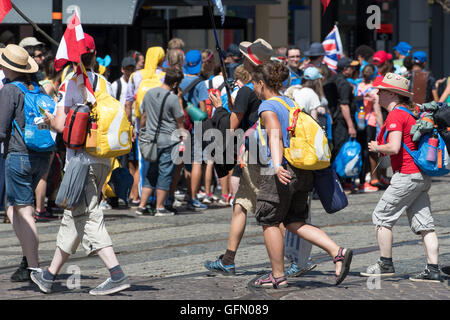 Pilgrims wait for a tram transfer in Krakow, Poland, 28 July 2016. The World Youth Day 2016 was held from 26 to - Stock Photo