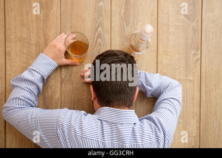 Man alcohol addicted feeling bad - Stock Photo
