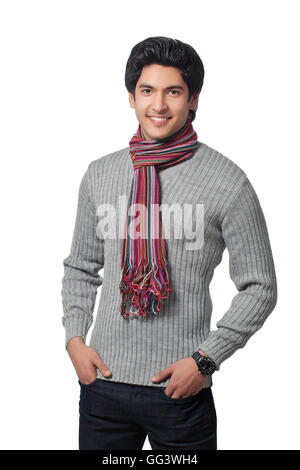 Portrait of young man wearing sweater - Stock Photo