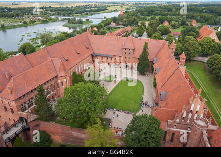The Castle of the Teutonic Order in Malbork and Nogat river seen from the top of the castle tower, Poland - Stock Photo