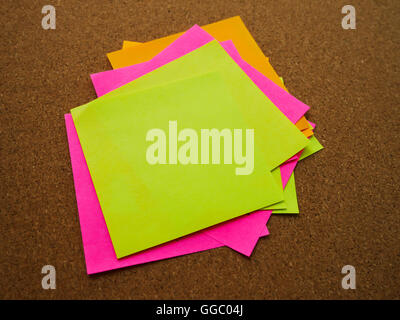 Many and colorful post note attach on wood board - Stock Photo